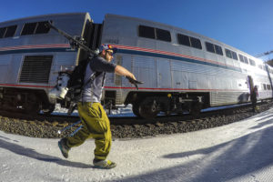 In this March 14, 2015 photo provided by Winter Park Ski Resort, a skier heads for his seat on the Winter Park ski train as it waits to leave from Winter Park, Colo., for Denver's Union Station. The historic train for skiers is resuming service from Denver's Union Station to the Rocky Mountains through 29 tunnels. (HO, Carl Frey/Winter Park Resort via AP)